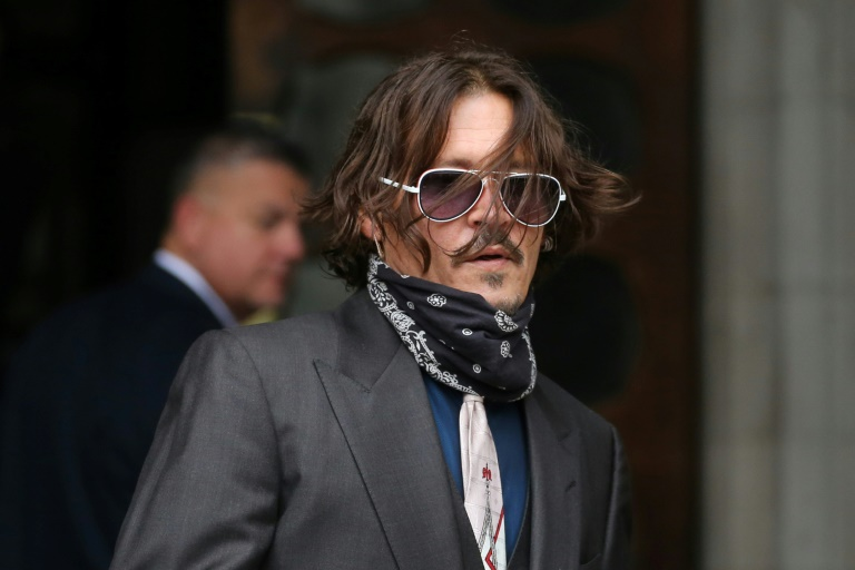 Johnny Depp denies slapping ex-wife