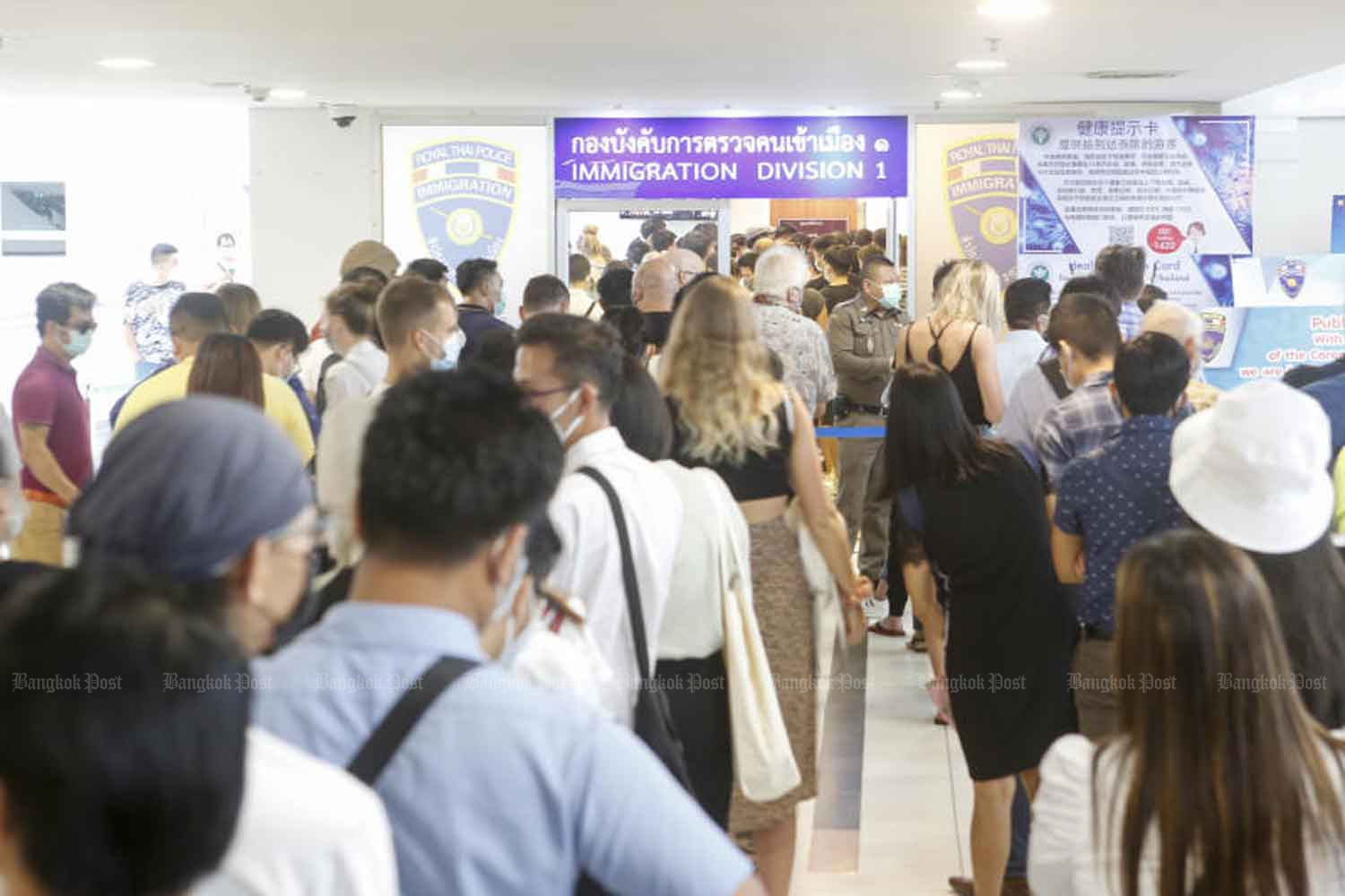Foreigners form long queues outside the immigration bureau office at the Government Complex in Bangkok in March, waiting to apply for visa extensions and other services after the Covid-19 pandemic disrupted their travel plans. (Photo: Pattarapong Chatpattarasill)