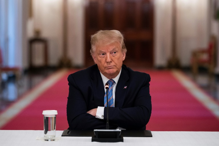 US President Donald Trump sits with arms crossed during a White House roundtable discussion on the Safe Reopening of America's Schools on July 7, 2020.