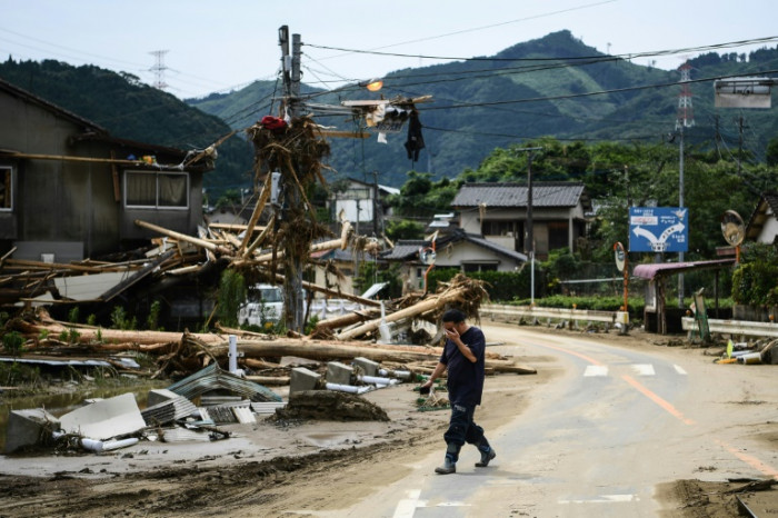 Japan rescuers battle to reach thousands trapped by floods