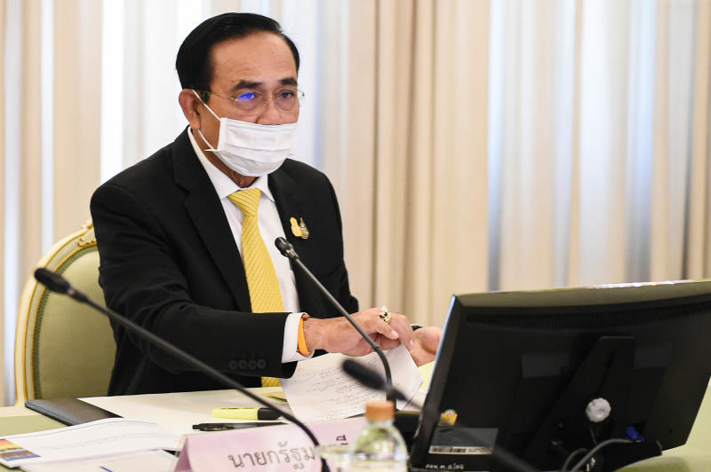 Prime Minister Gen Prayut Chan-o-cha chairs a meeting about economic recovery from the Covid-19 pandemic at Government House on Friday. (Government House photo)