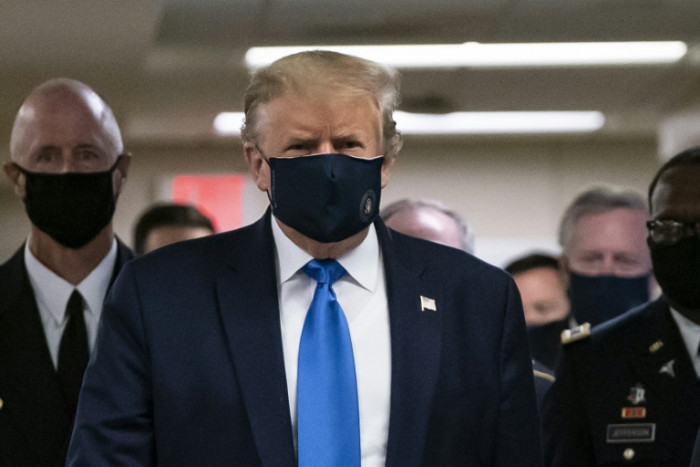 mask in seen face for first Trump time wearing public