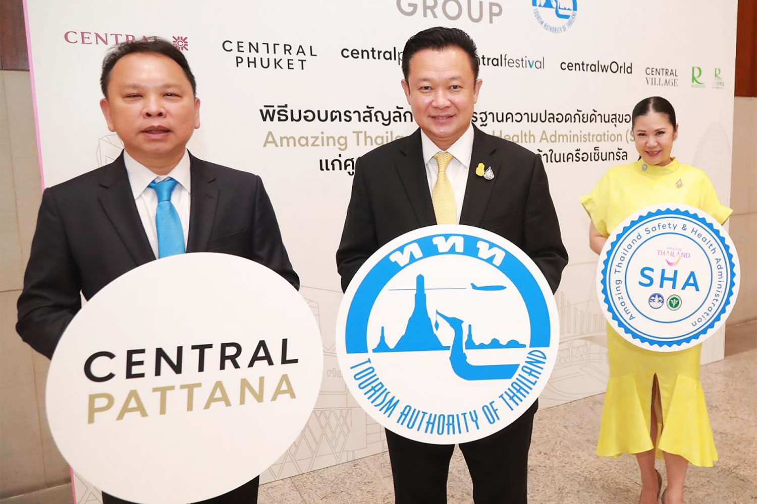 Nattakit Tangpoonsinthana (left), executive vice-president for marketing at CPN, receives the Amazing Thailand Safety & Health Administration (SHA) badge from TAT governor Yuthasak Supasorn (centre) and Thapanee Kiatphaibool, deputy governor for tourism products and business at the TAT.
