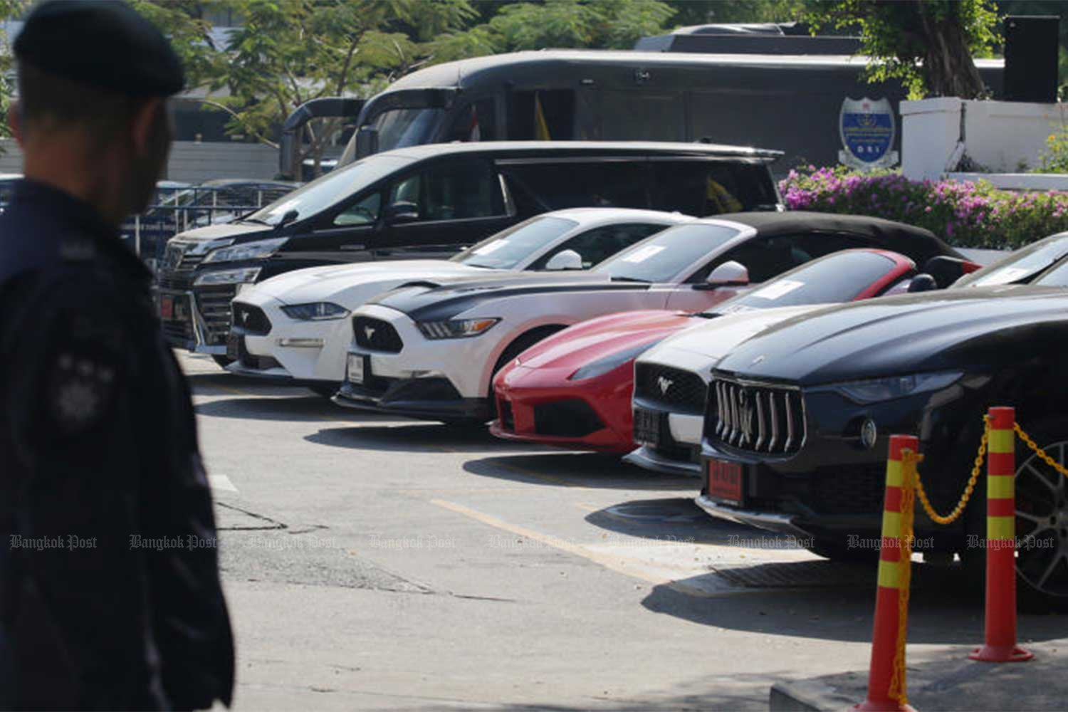 Seven seized luxury cars worth about 43 million baht in the DSI compound on Dec 10 last year - some of the assets seized from suspects in the Forex-3D scam. On Thursday, investigators seized another car, a 27 million baht Aston Martin registered to the chief suspect's wife that had been hidden in Ratchaburi. (File photo)