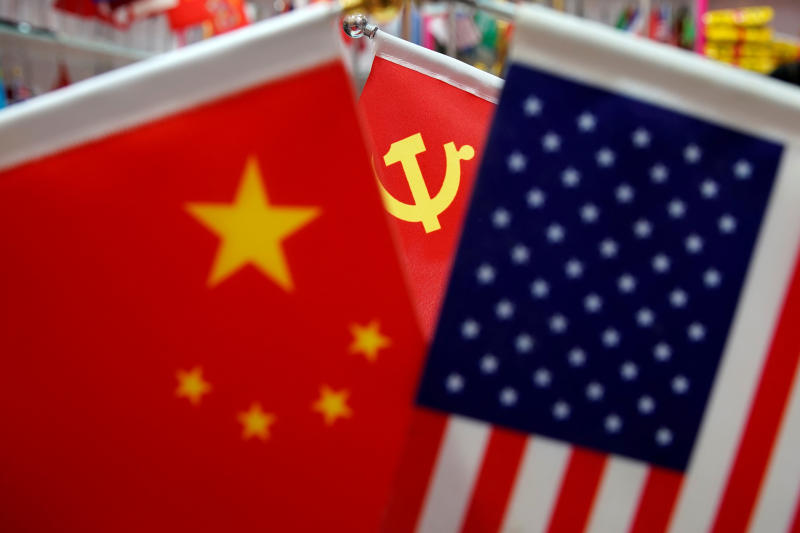 The flags of China, the US and China are displayed in a flag stall at the Yiwu Wholesale Market in Yiwu, Zhejiang province, China, May 10, 2019. (Reuters file photo)