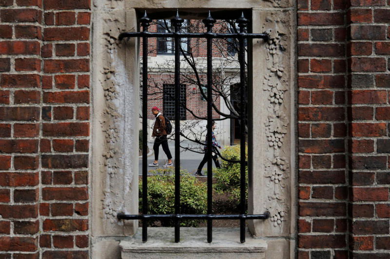 Students and pedestrians walk through the Yard at Harvard University in Cambridge, Massachusetts, on March 10, 2020. (Reuters photo)