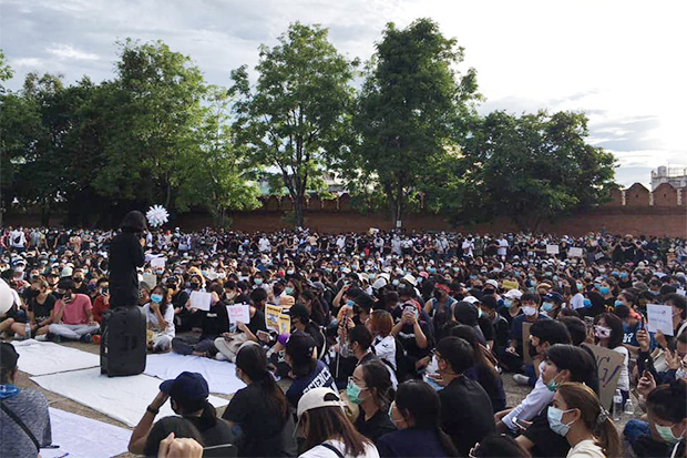 Protesters listen to a speaker during an anti-government rally at Tha Phae Gate in Chiang Mai city on Sunday. (Photo from Free Youth Facebook account)