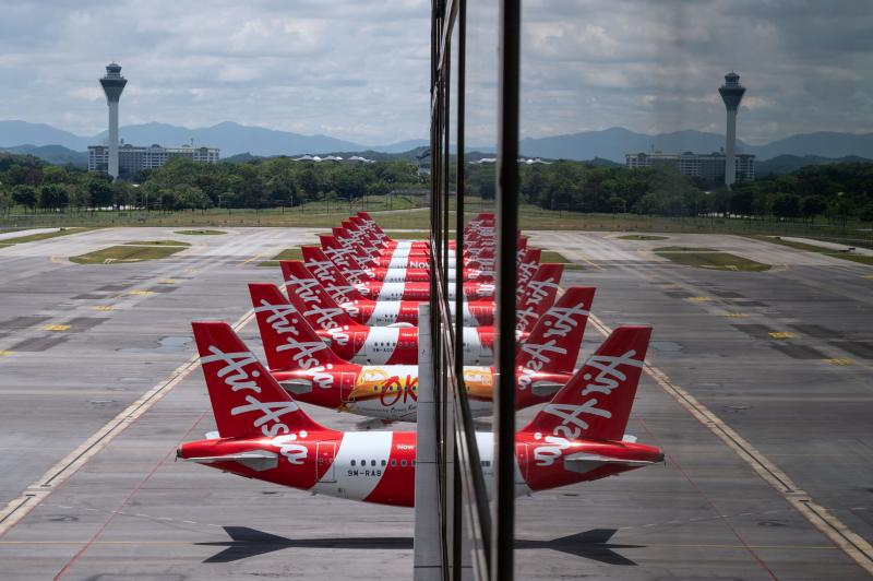 In this file photo taken on April 29, 2020, AirAsia aircraft are seen parked on the tarmac at the Kuala Lumpur International Airport 2 in Sepang. (AFP)