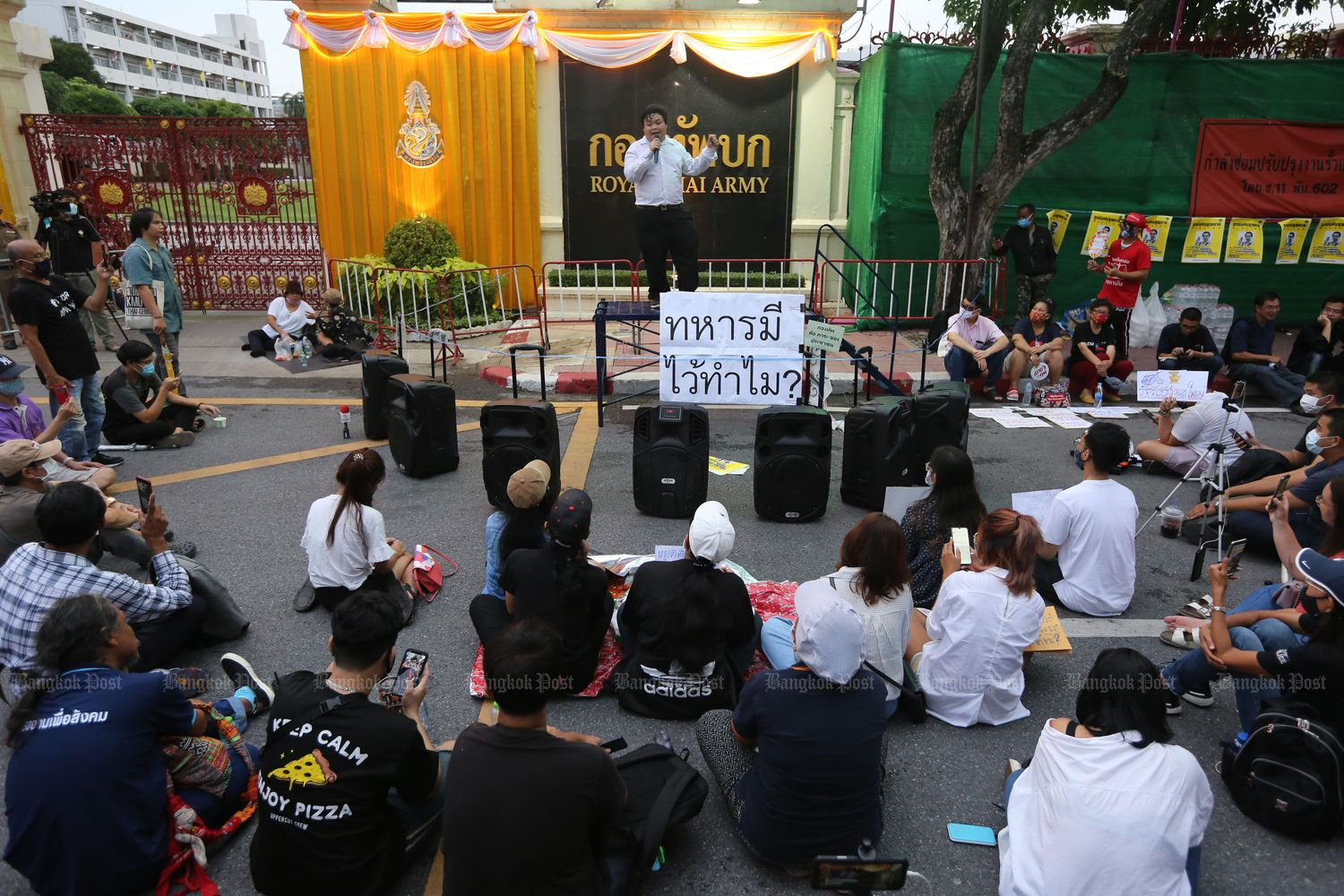A group of students gather in front of the army headquarters in Bangkok on Monday. (Photo by Wichan Charoenkiatpakul)