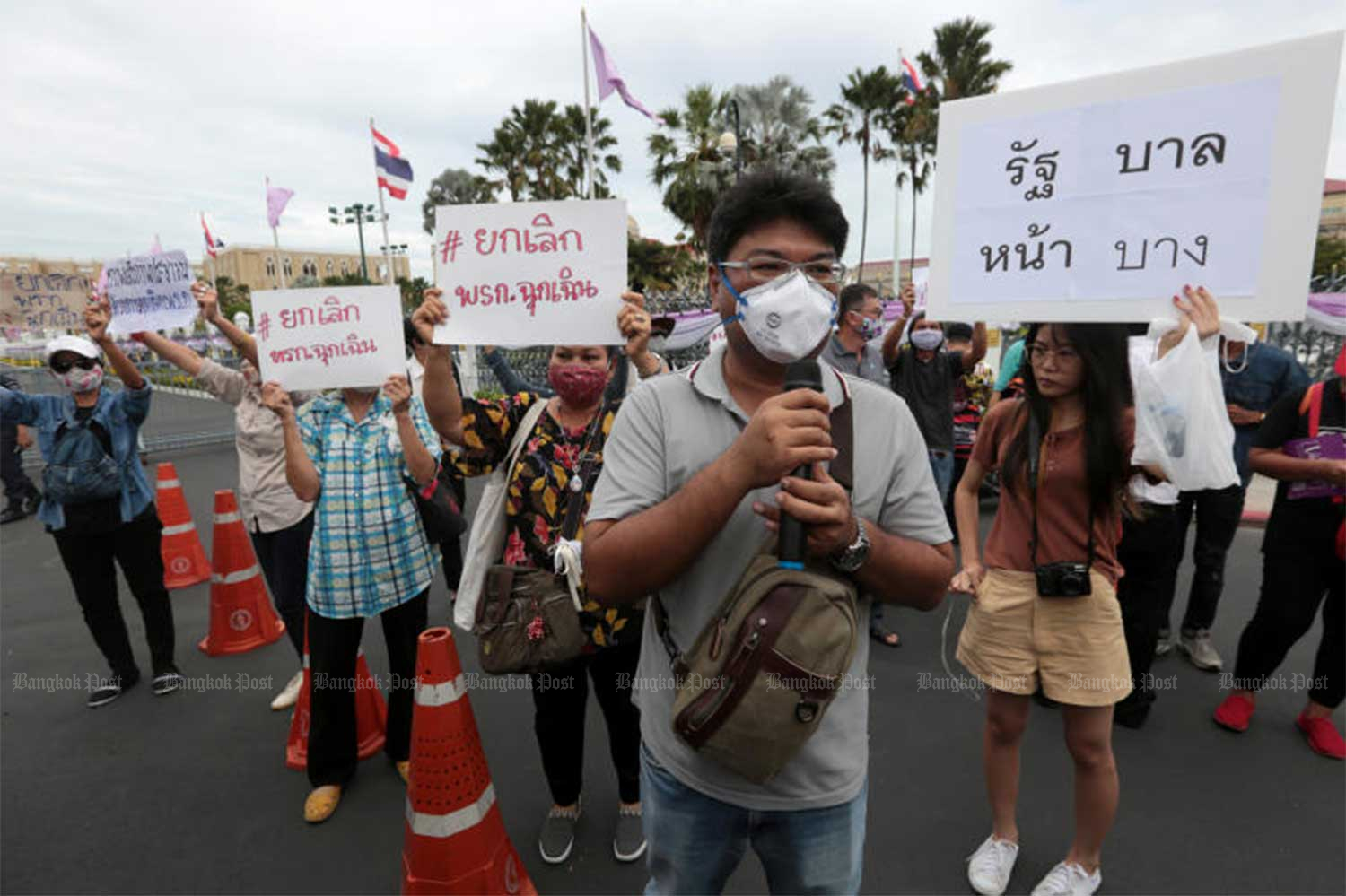 Members of the Democracy Restoration Group rally against the emergency decree outside Government House on June 18. (Bangkok Post file photo)