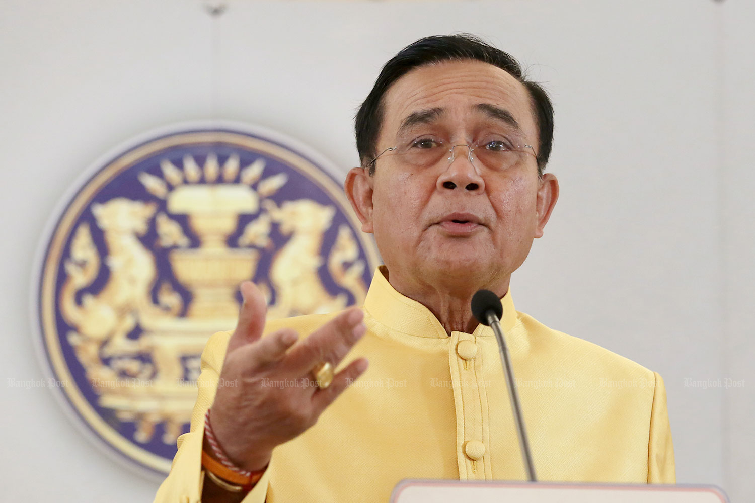 Prime Minister Prayut Chan-o-cha speaks following the weekly cabinet meeting at Government House on Tuesday. The meeting had few attendees as six ministers have quit to pave the way for a reshuffle. (Photo by Chanat Katanyu)