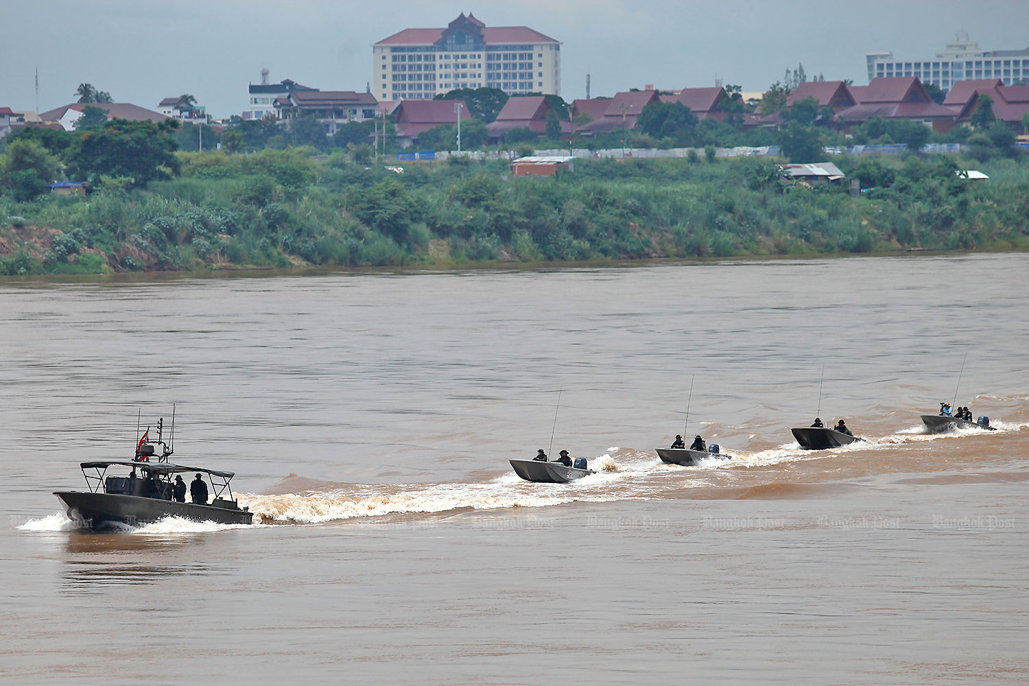 Here's the drill: The Mekong Riverine Unit holds a patrol drill along the Mekong River, a natural borderline, in Nong Khai yesterday. The unit practises a patrol manoeuvring formation as it navigates along one of the river's lanes for boat traffic. (Photo by Nutthawat Wicheanbut)