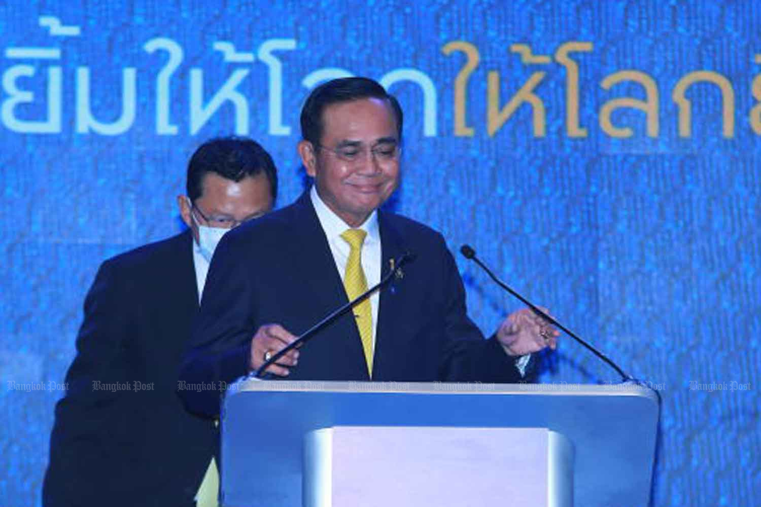 Prime Minister Prayut Chan-o-cha presides over a press briefing on the 'Thailand Smiles With You' campaign aimed at promoting domestic tourism in Bangkok on Thursday. (Photo by Somchai Poomlard)