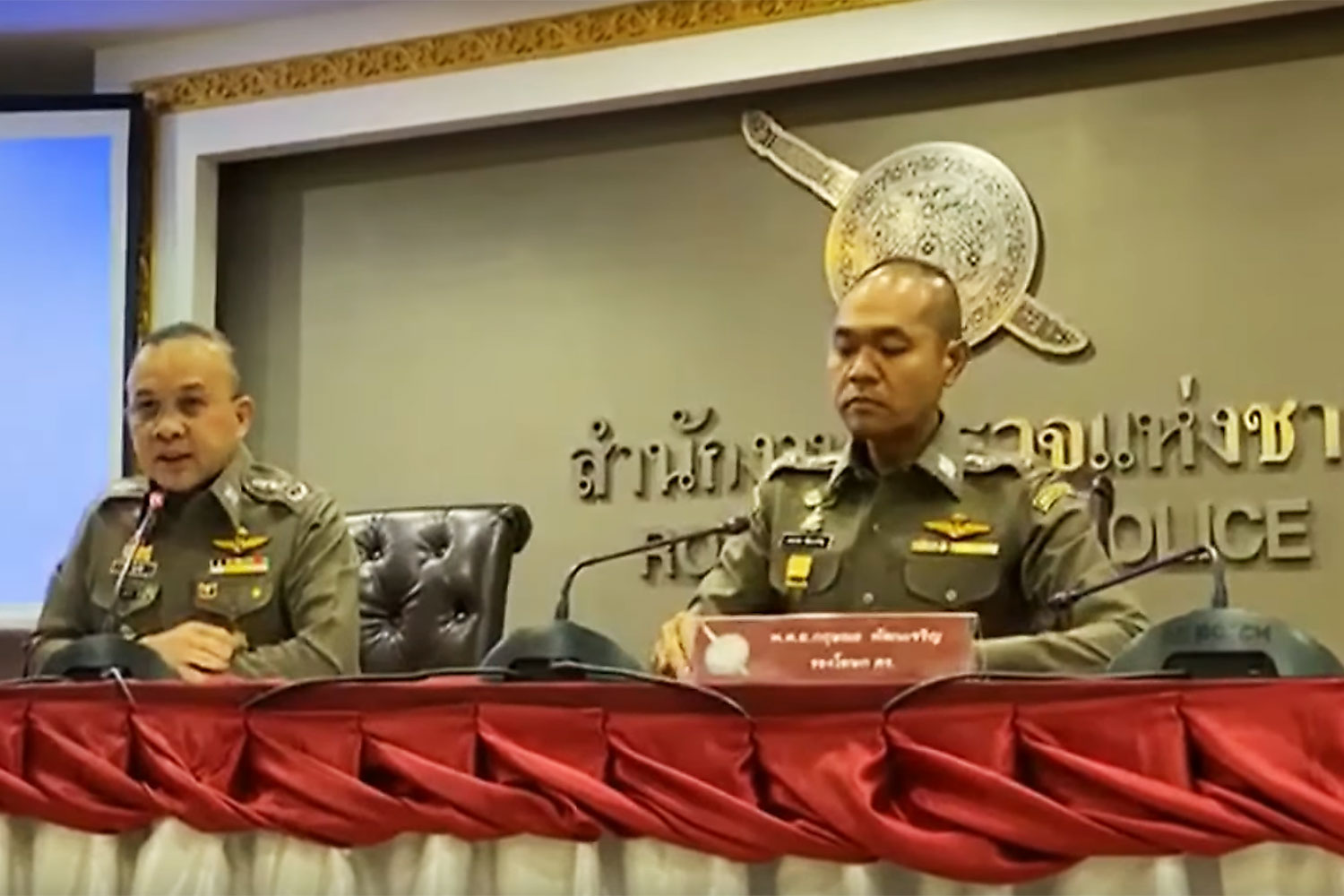 Police spokesman Pol Lt Gen Piya Uthayo, left, and deputy spokesman Pol Col Kritsana Pattanacharoen confirm all warrants for Vorayuth Yoovidhya have been revoked, at a media briefing in Bangkok on Friday. (Photo: ThaiPBS YouTube channel)
