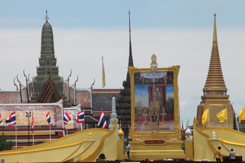 A portrait of His Majesty the King is seen at Sanam Luang, where a full day of religious and state ceremonies has been scheduled to mark the auspicious occasion.