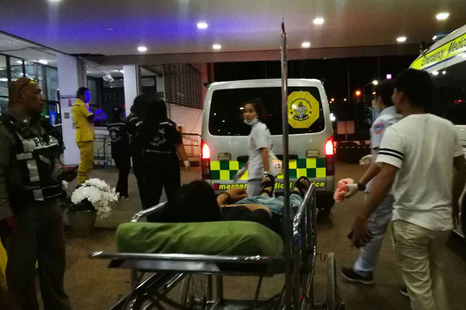 A young man injured during the restaurant brawl late on Monday night arrives by ambulance at Nang Rong Hospital, in Buri Ram province. One person was stabbed and two others hit by thrown bottles.(Photo: Surachai Piragsa)
