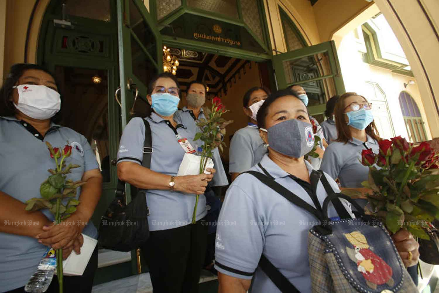 Representatives of village-based health volunteers at Government House in Bangkok to discuss Covid-19-related allowances on Wednesday, when the country logged six new coronavirus cases. (Photo: Pornprom Satrabhaya)