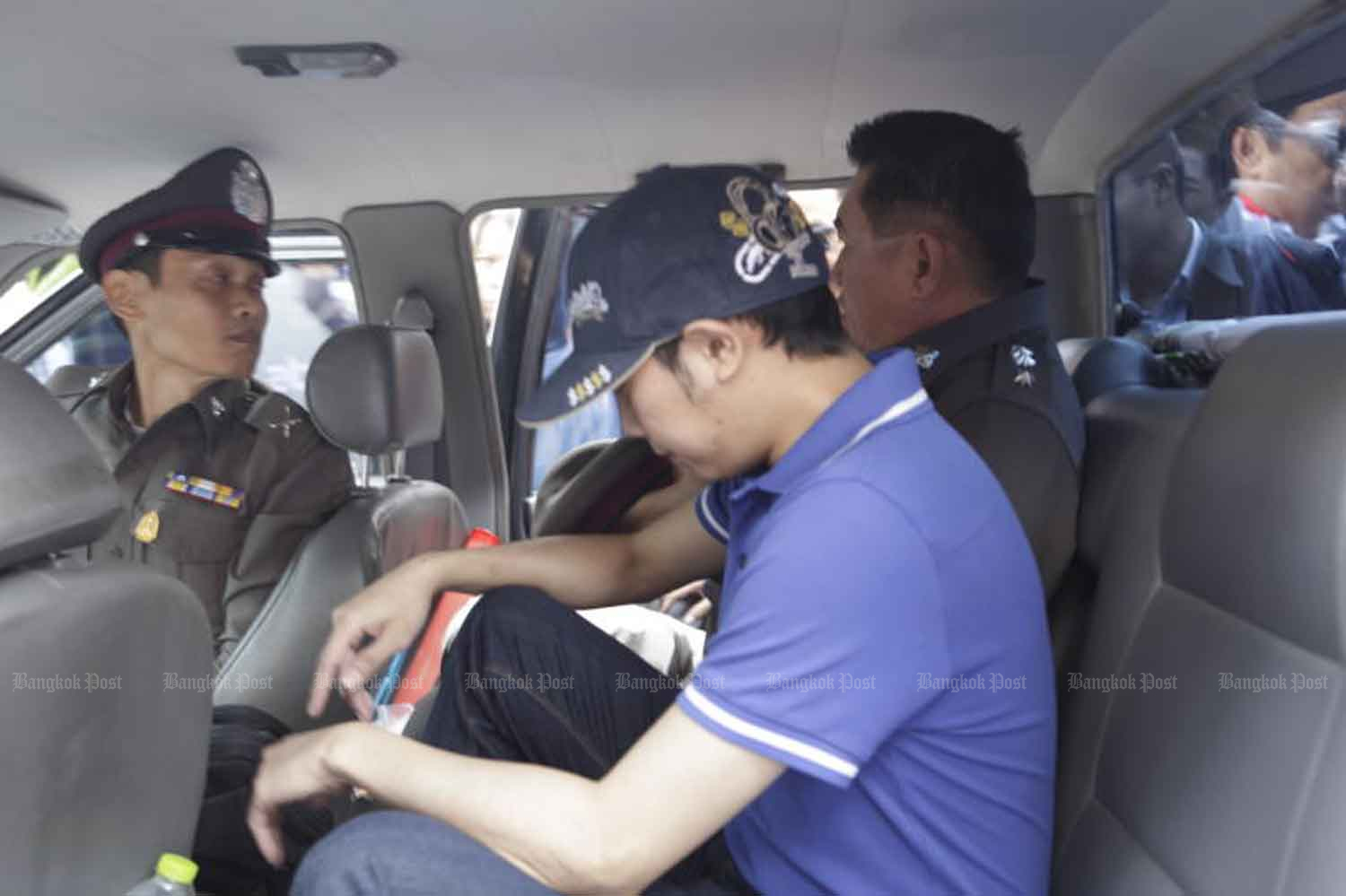 Vorayuth Yoovidhya is escorted to the Thong Lor police station in Bangkok for interrogation, hours after a crash that killed a police officer on Sept 3, 2012. (Photo: Kosol Nakachol)