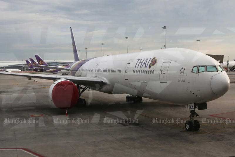 A Thai Airways International jet sits parked on the tarmac of Suvarnabhumi airport. (Photo by Wichan Charoenkiatpakul)