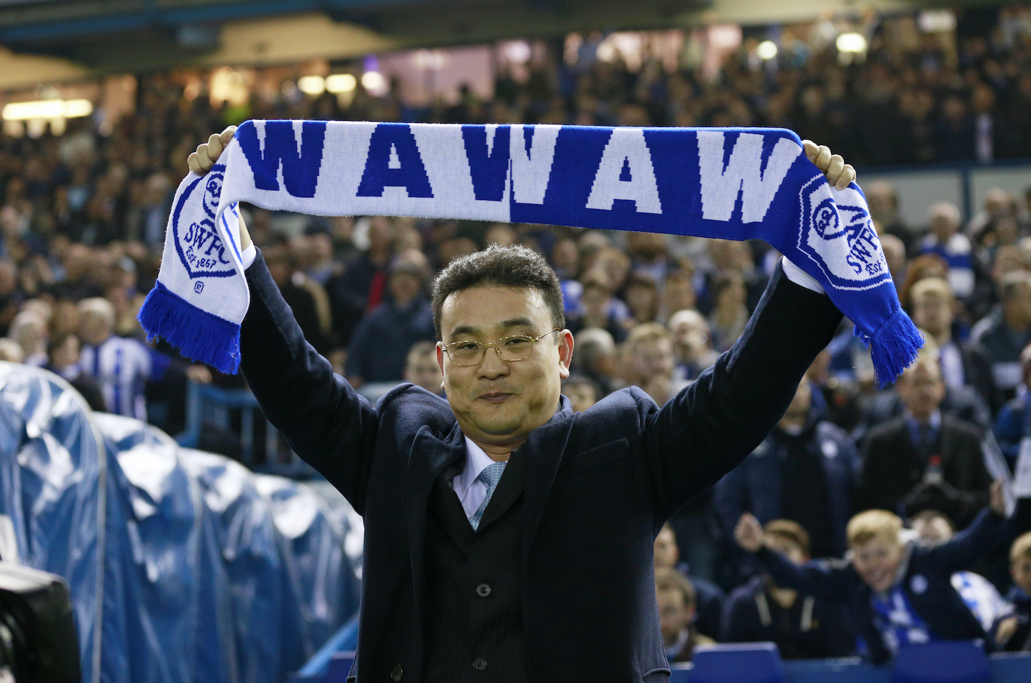Sheffield Wednesday owner Dejphon Chansiri cheers on his side during a Capital Cup match against Arsenal in October 2015. (Reuters file photo)