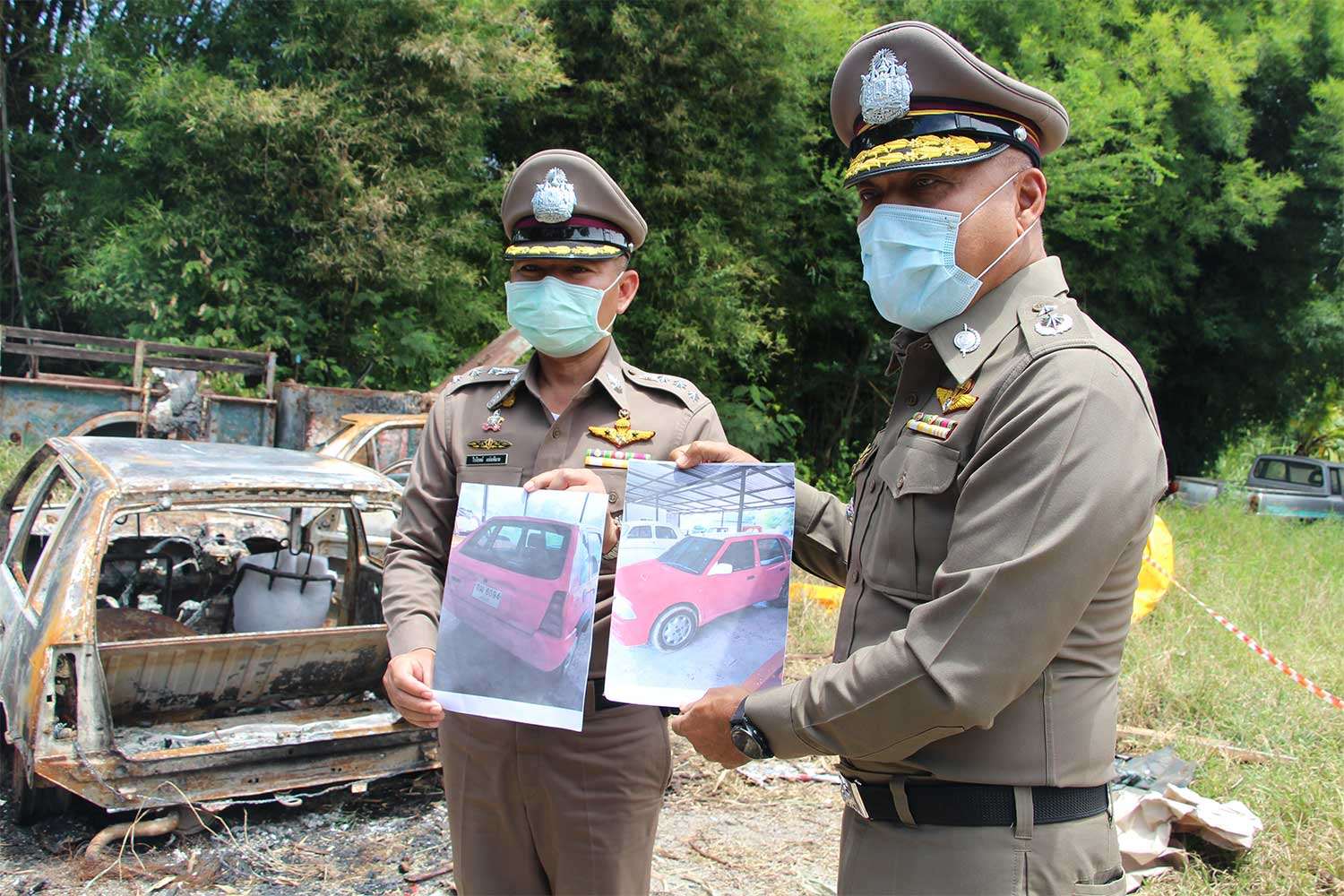 Police show pictures of a red car before it was set on fire by a car upholstery shop owner who was trying to fake his death, in Chom Bung district of Ratchaburi. (Photo by Saichon Srinuanchan