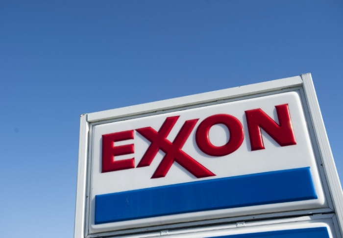US oil giants report big losses, prepare for longer downturn