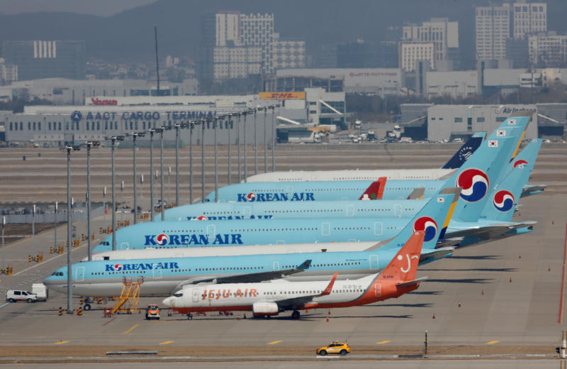 Korean Air's passenger planes are parked at on the tarmac at Incheon International Airport on March 24, 2020 as overseas flight routes are reduced. (Reuters photo)