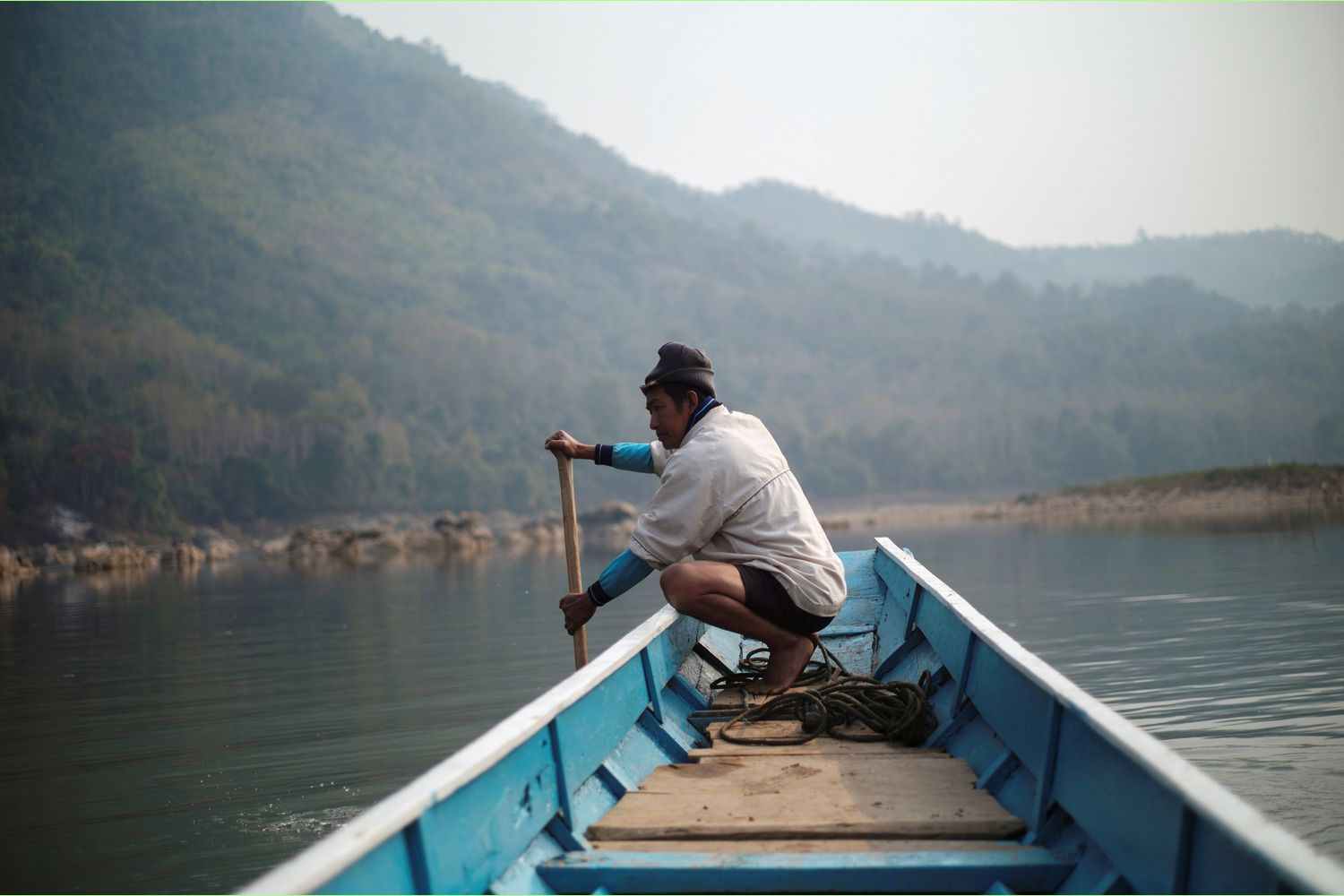 A local villager drives a boat where the future site of the Luang Prabang dam will be on the Mekong River, outskirt of Luang Prabang province, Laos, in February. (Reuters photo)