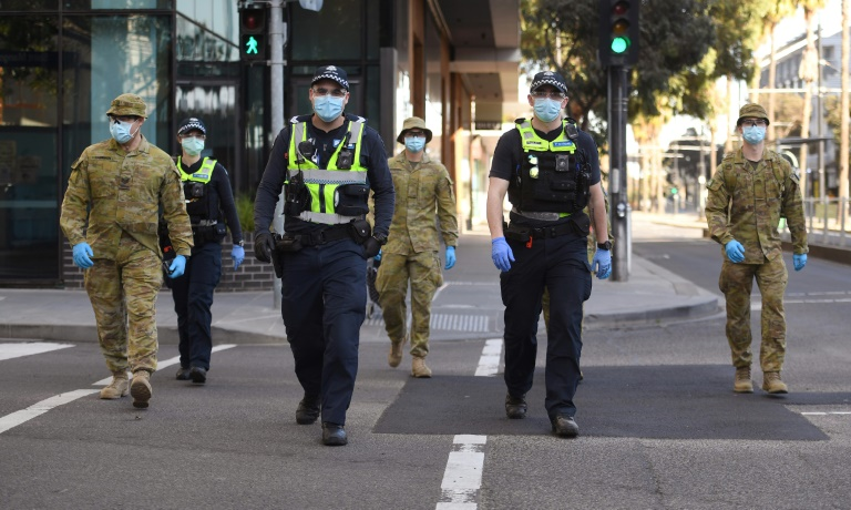 Police and soldiers are patrolling Melbourne as part of new restrictions against an upswing in infections.