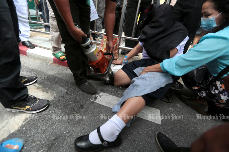 Student's leg plunges into hole outside Government House