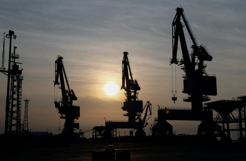 Cranes silhouetted against the setting sun at Tanjung Priok port on Monday, amid the coronavirus outbreak in Jakarta. (Photo: Reuters)