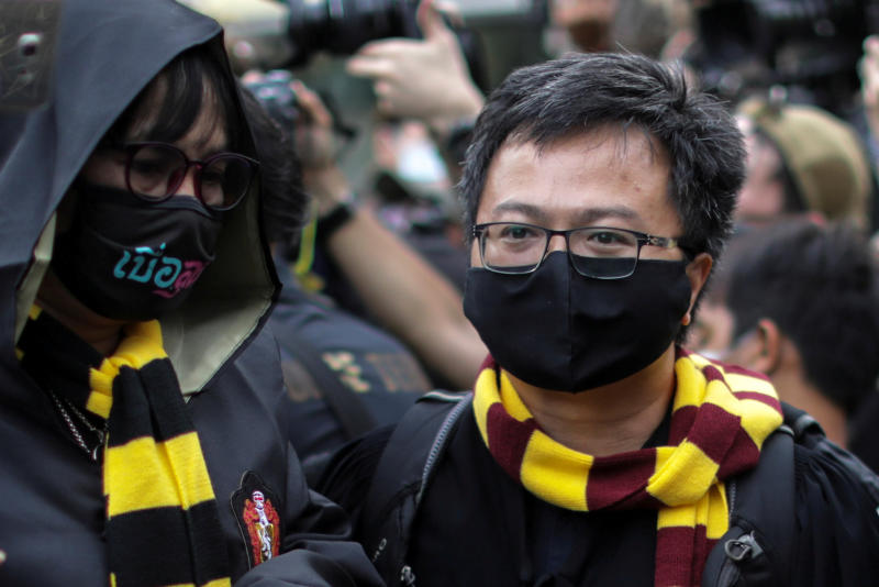 Anon Nampa (right), dressed as a wizard, attends a Harry Potter-themed protest demanding the resignation of Prime Minister Prayut Chan-o-cha in Bangkok on Monday. (Reuters photo)