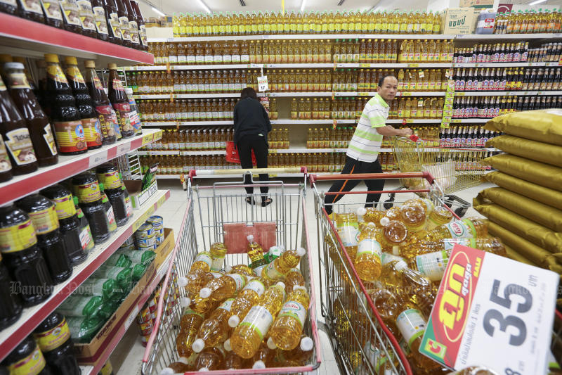 Consumers shop at a supermarket passing discounted goods. Inflation dropped smaller than expected last month. (Photo by Patipat Janthong)