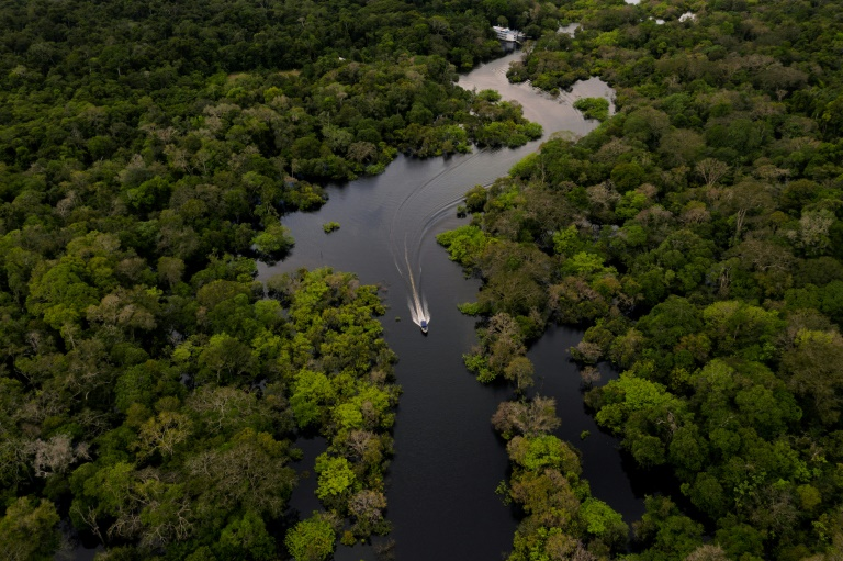 A boat travels on the Jurura river in Carauari, in the heart of the Brazilian Amazon rainforest, in March 2020 -- the entire region is facing many challenges, and now must battle the coronavirus crisis as well