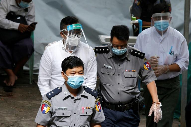 David Lah is escorted for trial in Yangon on June 8.