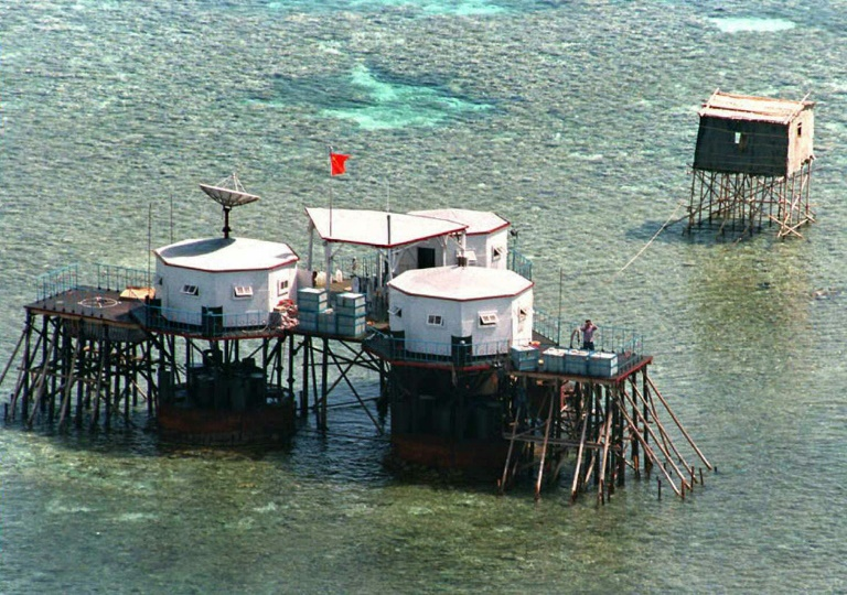 This file photo taken on April 1, 1995 shows China's flag flying over octagonal structures built on stilts at a reef claimed by the Philippines in the South China Sea, one of many sources of tension between China and the US.