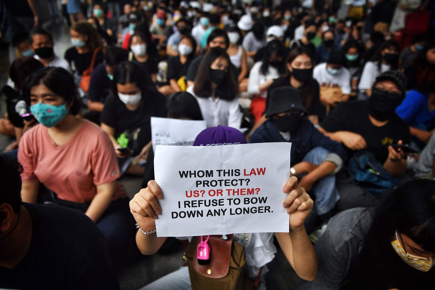 Protesters call for the dissolution of the House during a rally at the Skywalk in Bangkok on Saturday. (AFP photo)