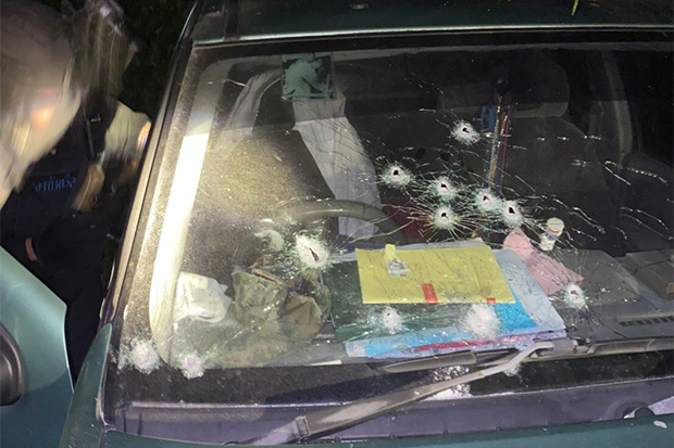 Bullet holes are seen in the windscreen of a pickup truck owned by Warrant Officer Serm Seedaeng after he was attacked in Bacho district of Narathiwat on Saturday. (Photo by Adbullah Benjakat)