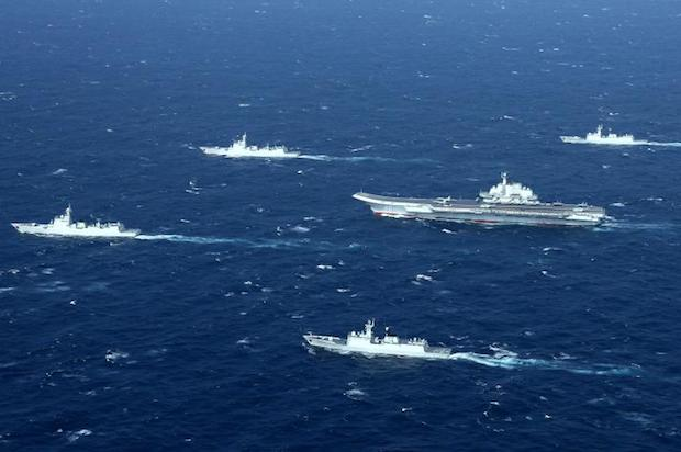 This aerial file photo taken on Jan 2, 2017 shows a Chinese Navy formation, including the aircraft carrier Liaoning (centre), during military drills in the South China Sea.(AFP)
