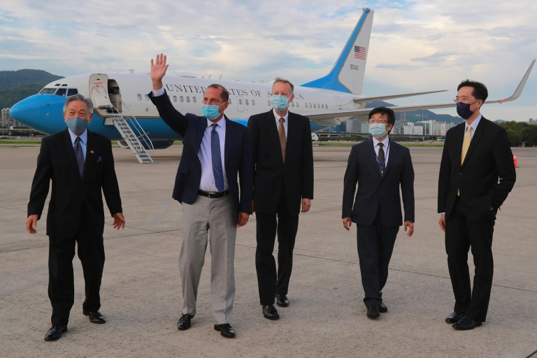US Health Secretary Alex Azar (second left) waves following his arrival at the Sungshan Airport in Taipei.
