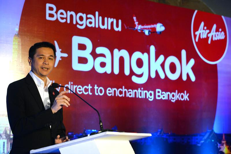 FILE PHOTO: Chief Executive Officer of Thai AirAsia, Tassapon Bijleveld addresses media representatives during the launch of Thai Air Asia's direct flights from Bangalore to Bangkok in Bangalore on June 29, 2015. (AFP)