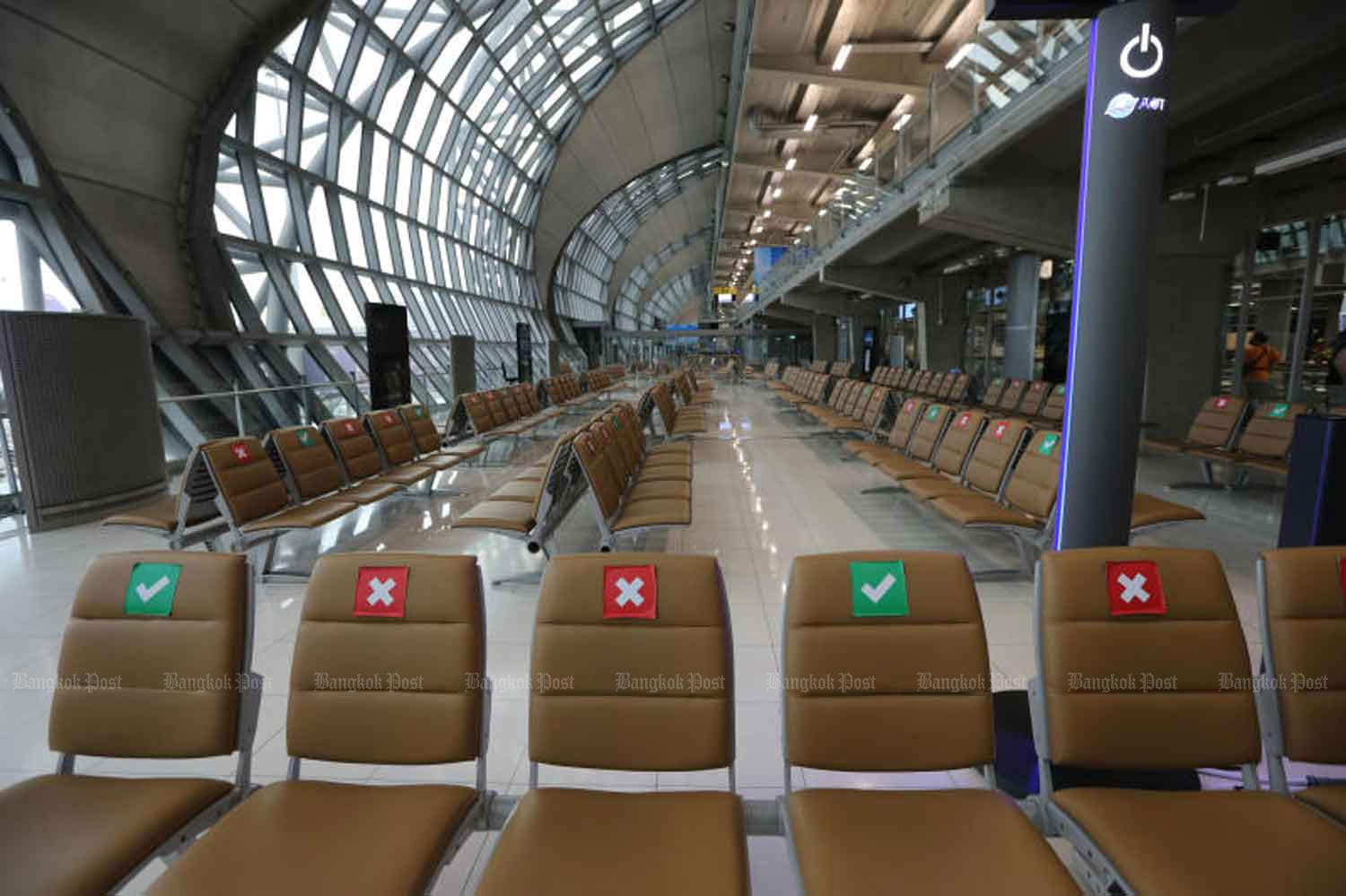 Empty seats at Suvarnabhumi airport in Samut Prakan province last month. (Photo by Wichan Charoenkiatpakul)