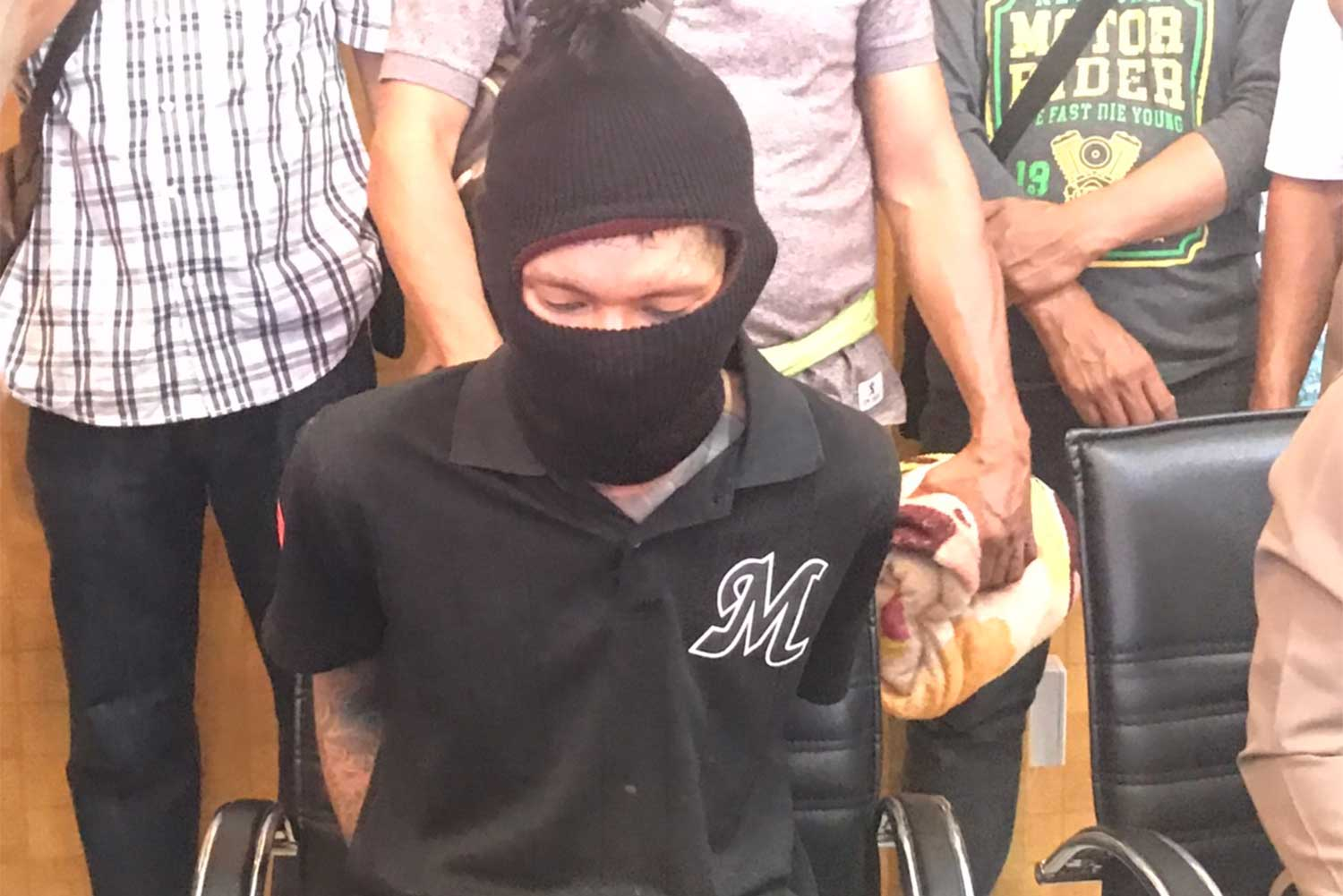 Suspect Theeraphol Duangkrathok, 26. Arrested on Thursday and charged with stabbing to death a 29-year-old woman, a wife of a Singaporean businessman, at her house in Nakhon Ratchasima on Tuesday afternoon. (Photo: Prasit Tangprasert)