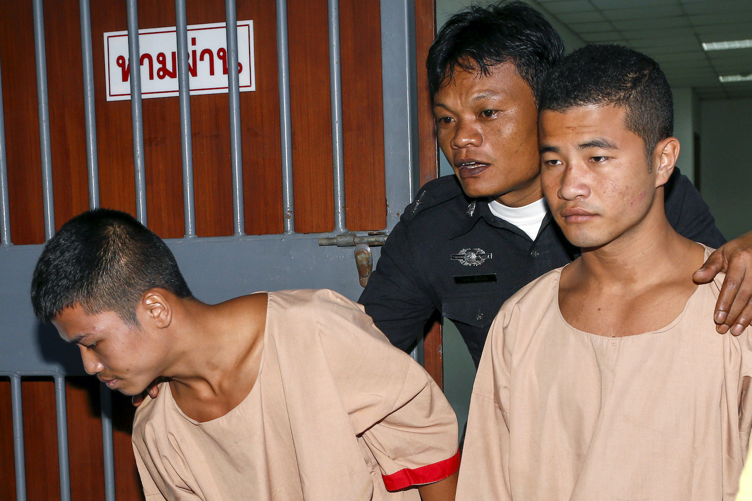 Migrant workers Zaw Lin and Win Zaw Htun leave the Koh Samui provincial court in Koh Samui after being found guilty of murder on Dec 24, 2015. (Reuters File Photo)