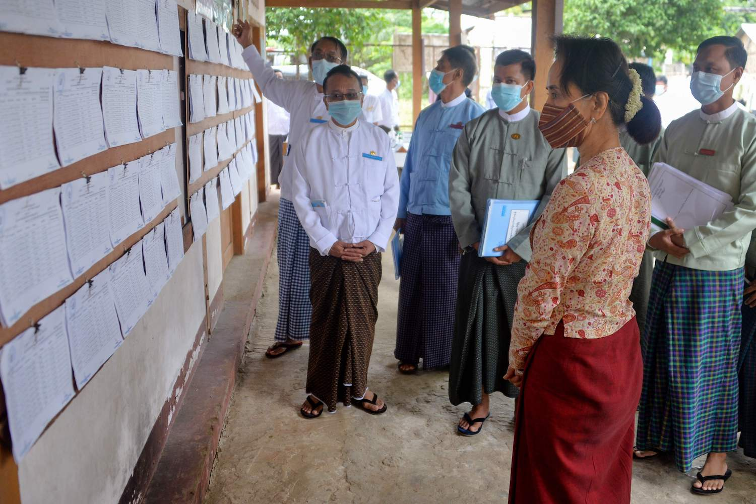 State Counsellor Aung San Suu Kyi looks at voters' lists at an administrative office in Nay Pyi Taw, the capital of Myanmar, on Friday. Her party is widely expected to win the general election in November. (AFP Photo)