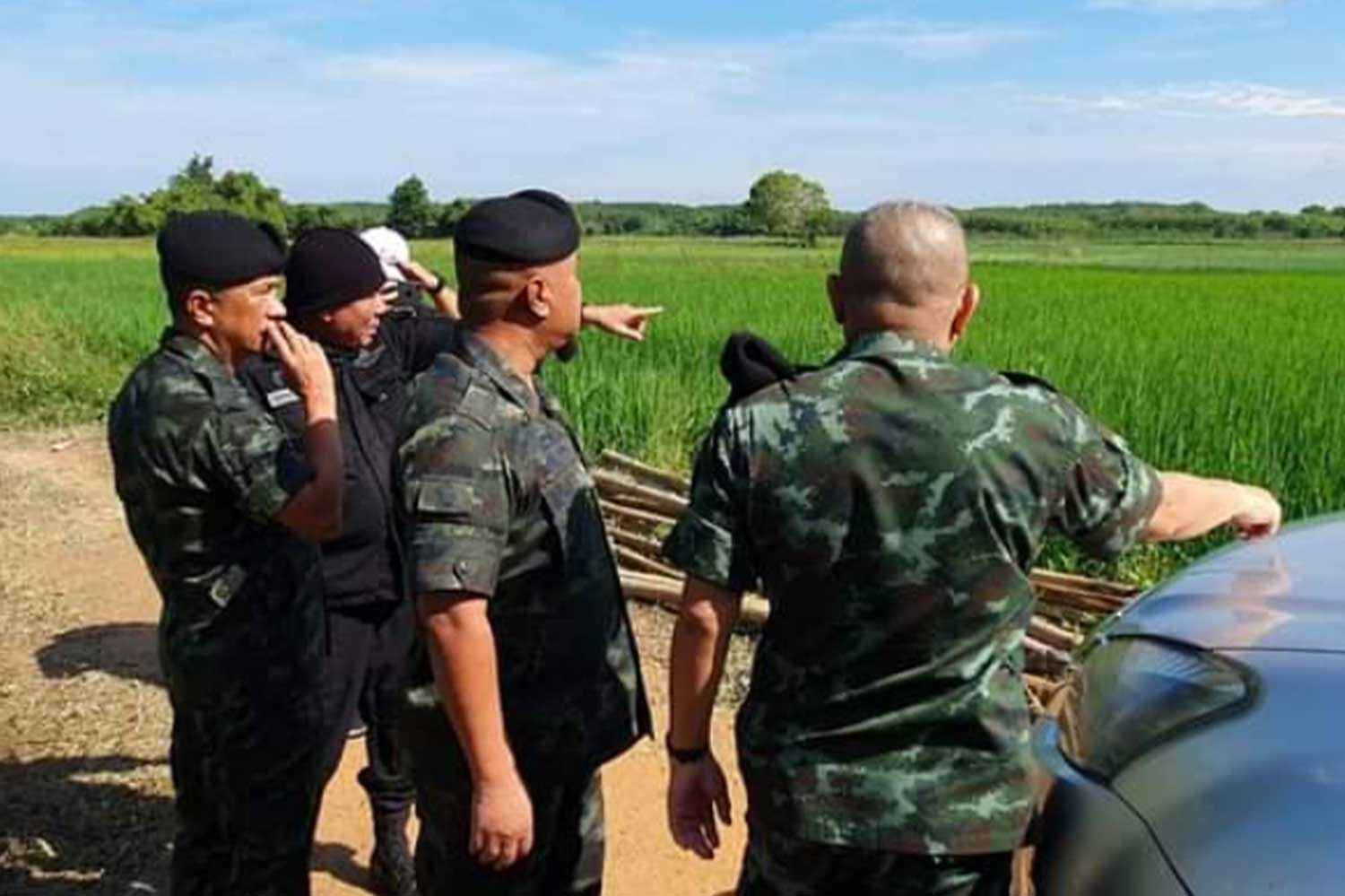 Military officers on Saturday inspect the scene of a clash in Yarang district of Pattani, where two insurgents died in a firefight on Friday night and two others on Saturday morning. (Photo by Abdullah Benjakat)