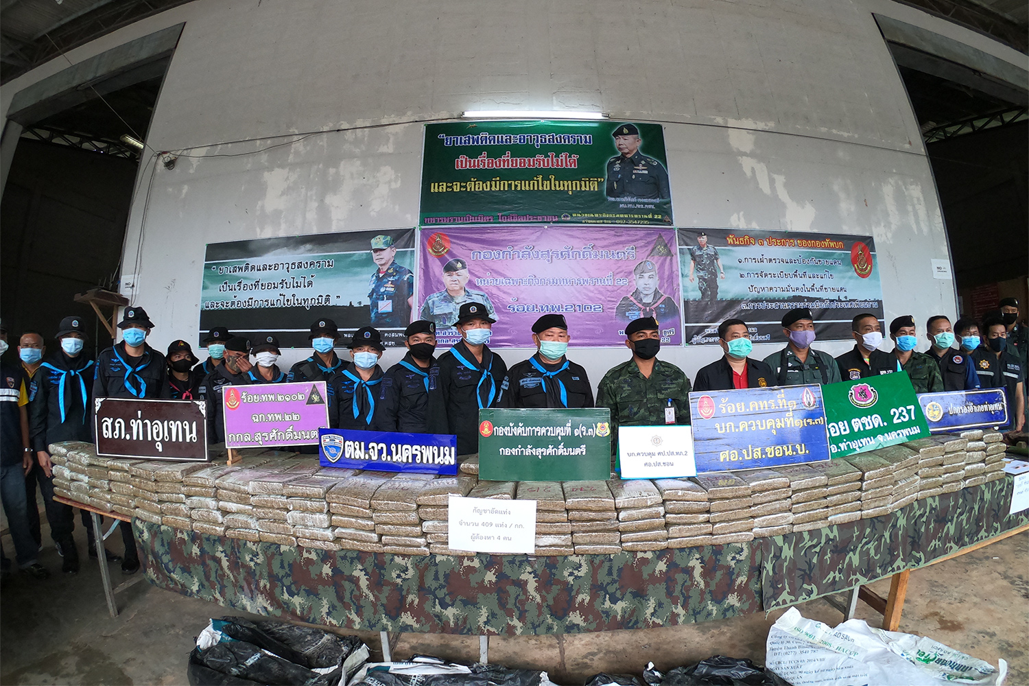 Security authorities display more than 400 kilogrammes of comprssed marijuana seized in Tha Uthen district of Nakhon Phanom on Saturday night. (Photo by Pattanapong Sripiachai)