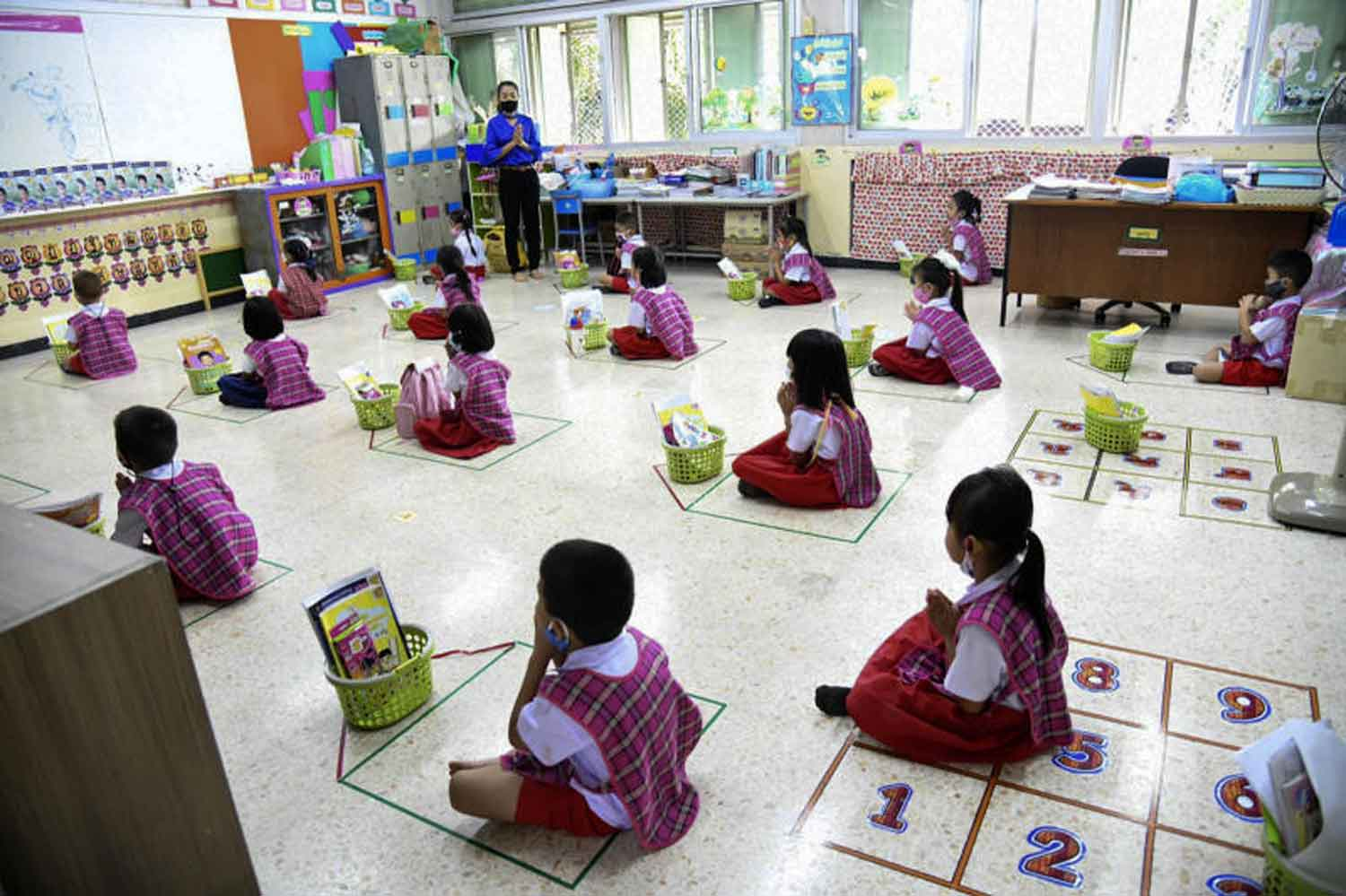 Young students practise social distancing in a classroom at Thung Song Hong School in the Lak Si district of Bangkok last week. The government reported three new Covid-19 cases on Tuesday. (Photo by Bangkok Metropolitan Administration)