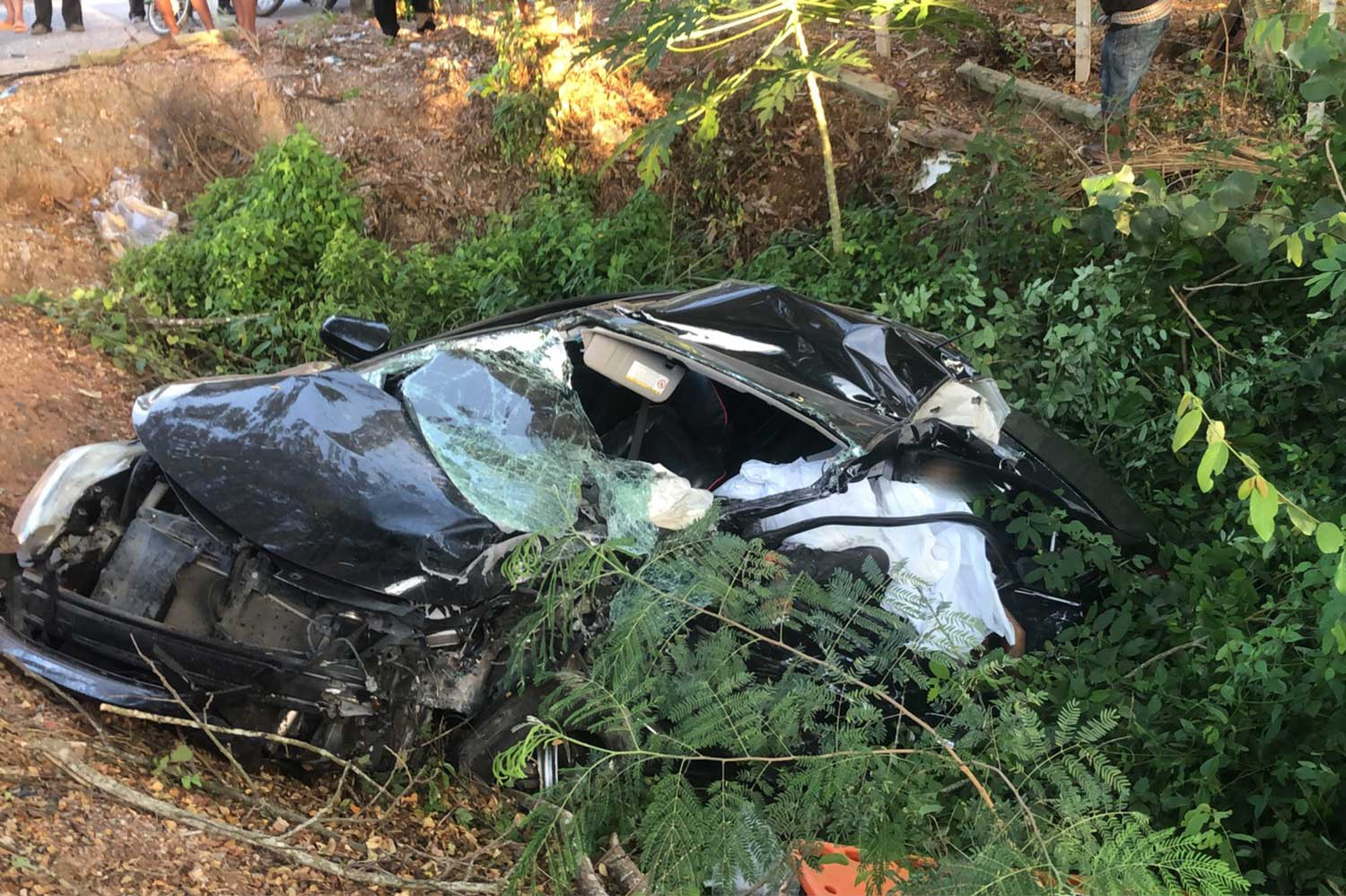 The wreckage of the Toyota Yaris sedan after it and a pickup collided head-on in Nakhon Si Thammarat province on Thursday evening. The three people in the car were killed. One was pregnant. (Photo: Nujaree Raekrun)
