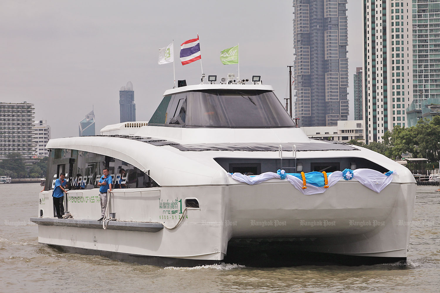 Energy Absolute introduced Thailand's first-ever registered electric ferry, the Mine Smart Ferry, yesterday on the Chao Phraya River. (Photo by Apichart Jinakul)